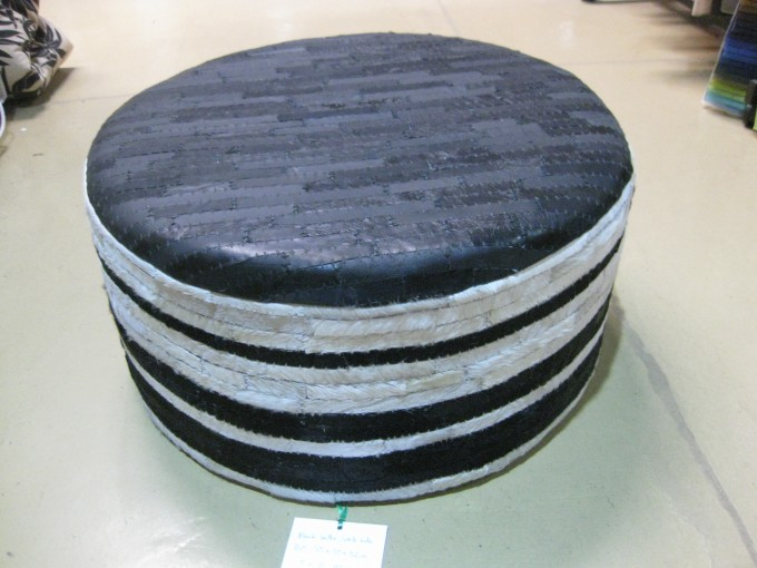 A Funky Round Cowhide Ottoman With Plated Color Touching