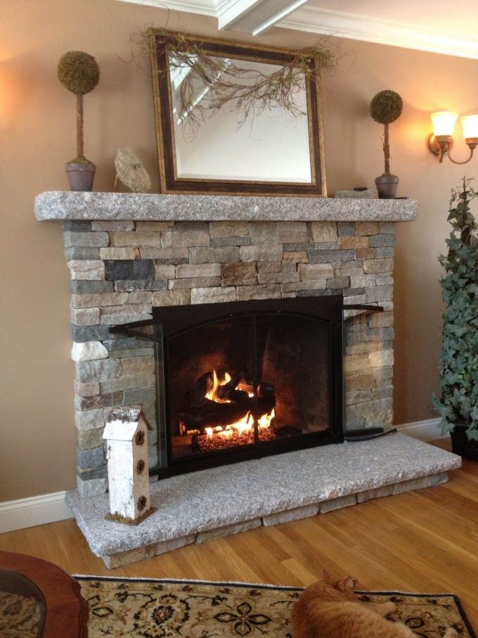 Astounding Corner Stone Fireplace Mantel Kits With Picture Mirror And Lamp On Tan Wall