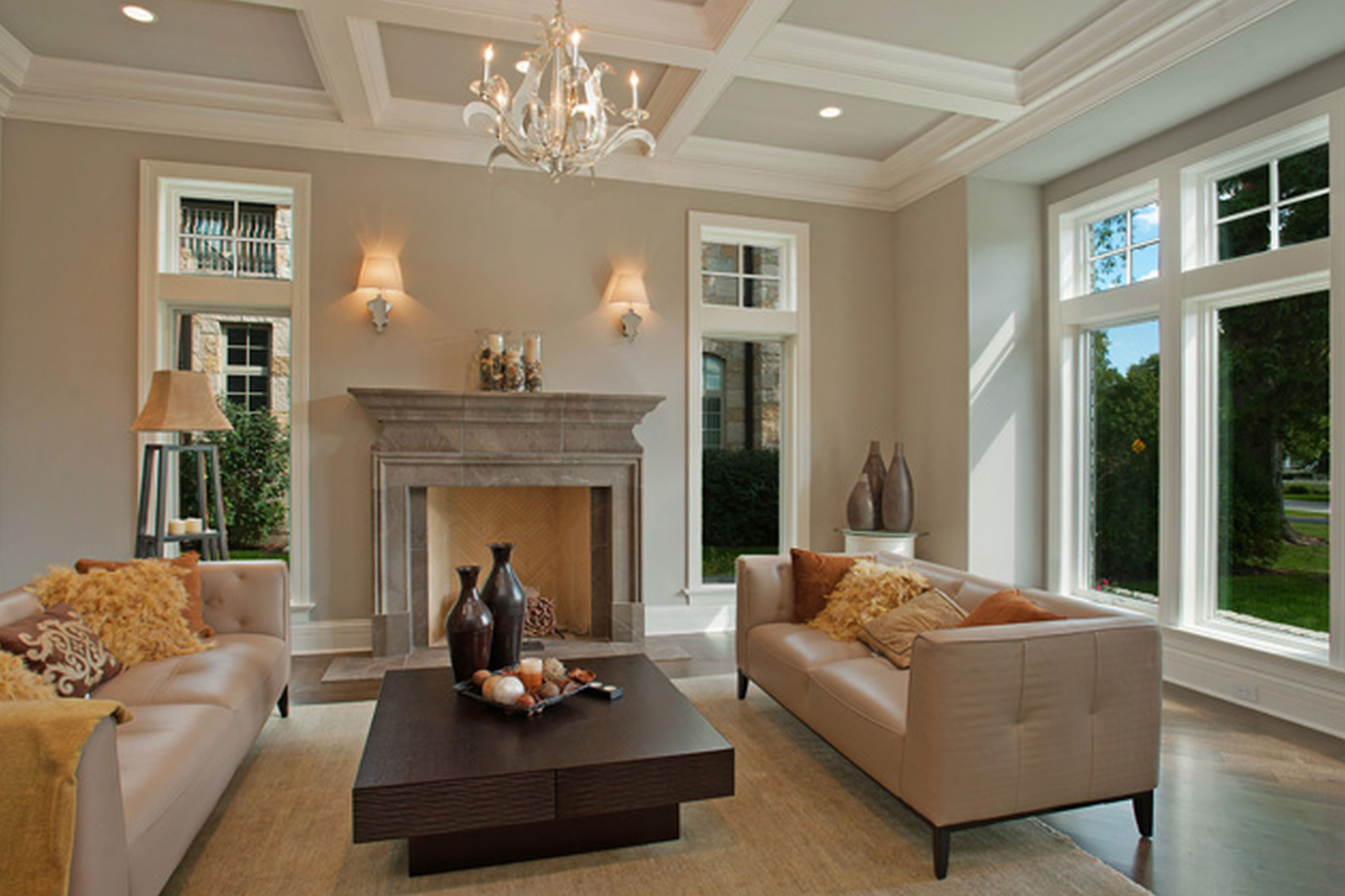 awesome Fireplace Mantel kits between glass windows with modern sofa and wooden floor plus chandelier for inspiring home decor ideas