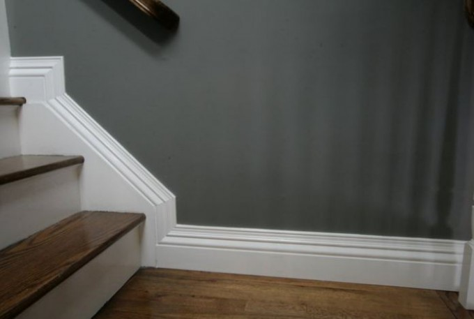 Baseboard Molding For Stairs Area With Grey Wall And Wooden Floor