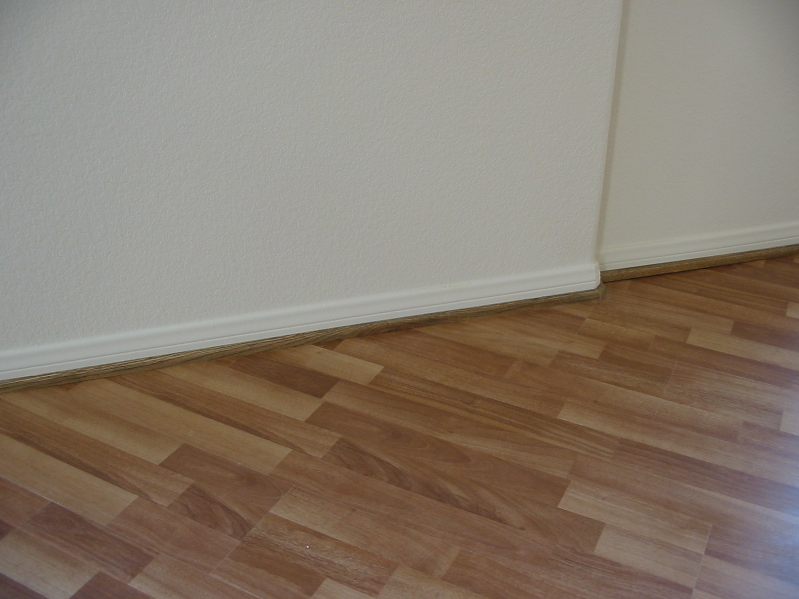 baseboard molding matched with white wall