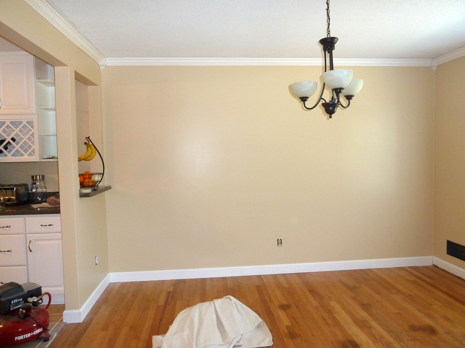 Baseboard Molding on top and bottom with cream wall and white ceiling plus wooden floor