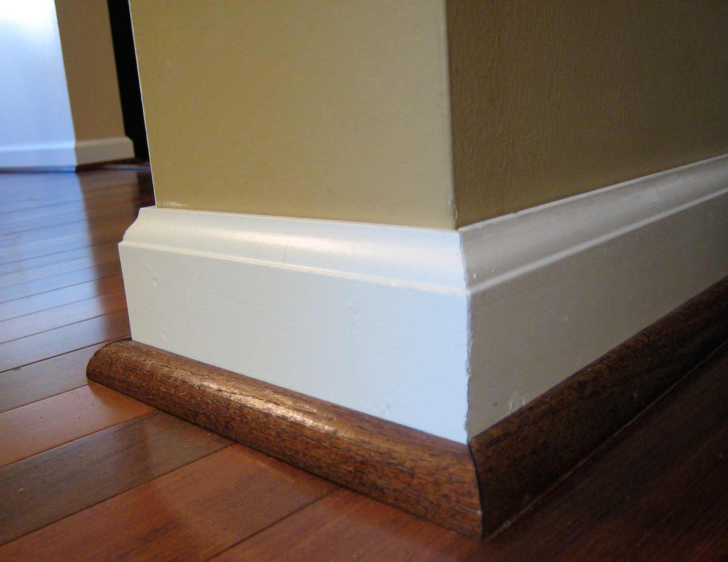 Baseboard Molding Styles Selecting Guide with tan wall