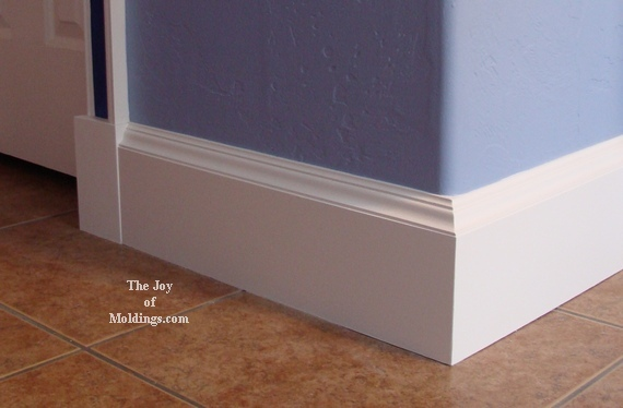 baseboard molding with blue wall and wooden floor looks nice