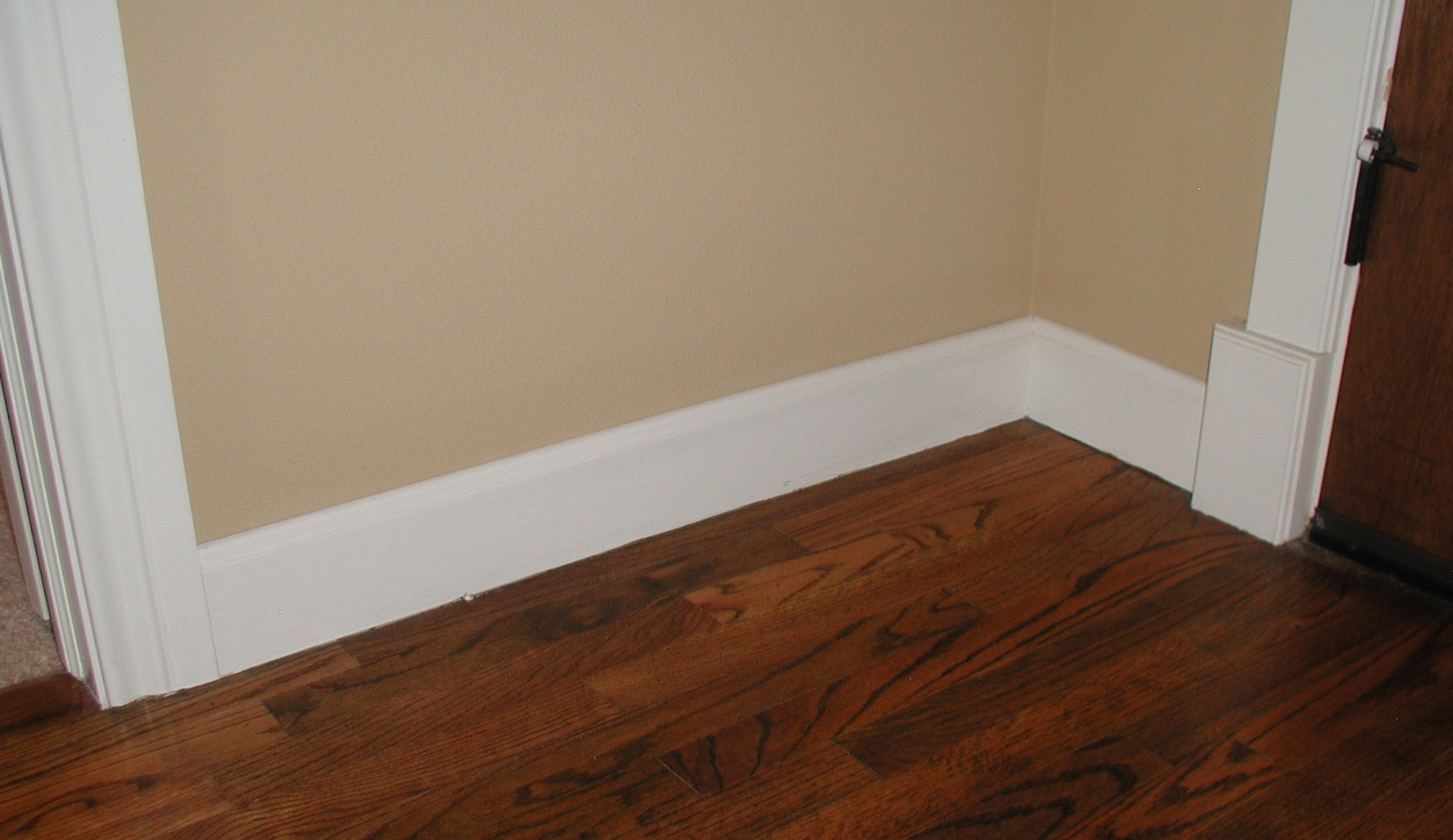 How to cut base molding in place - Baseboard Molding With Cream Wall And Wooden Floor Ideas