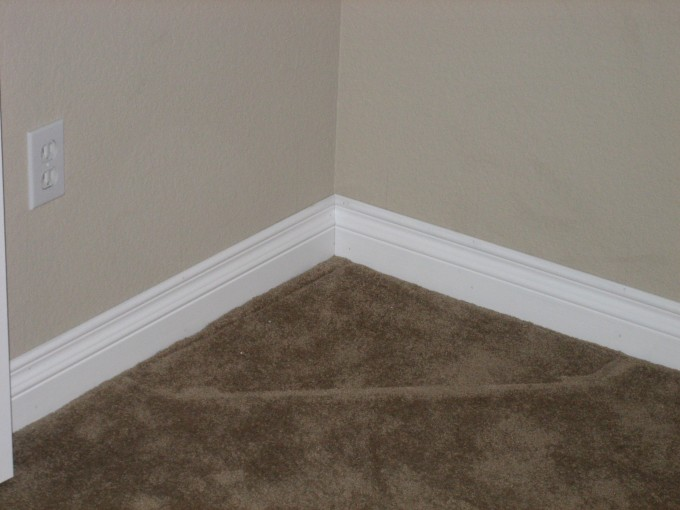 Baseboard Molding With Grey Wall And Rosybrown Floor