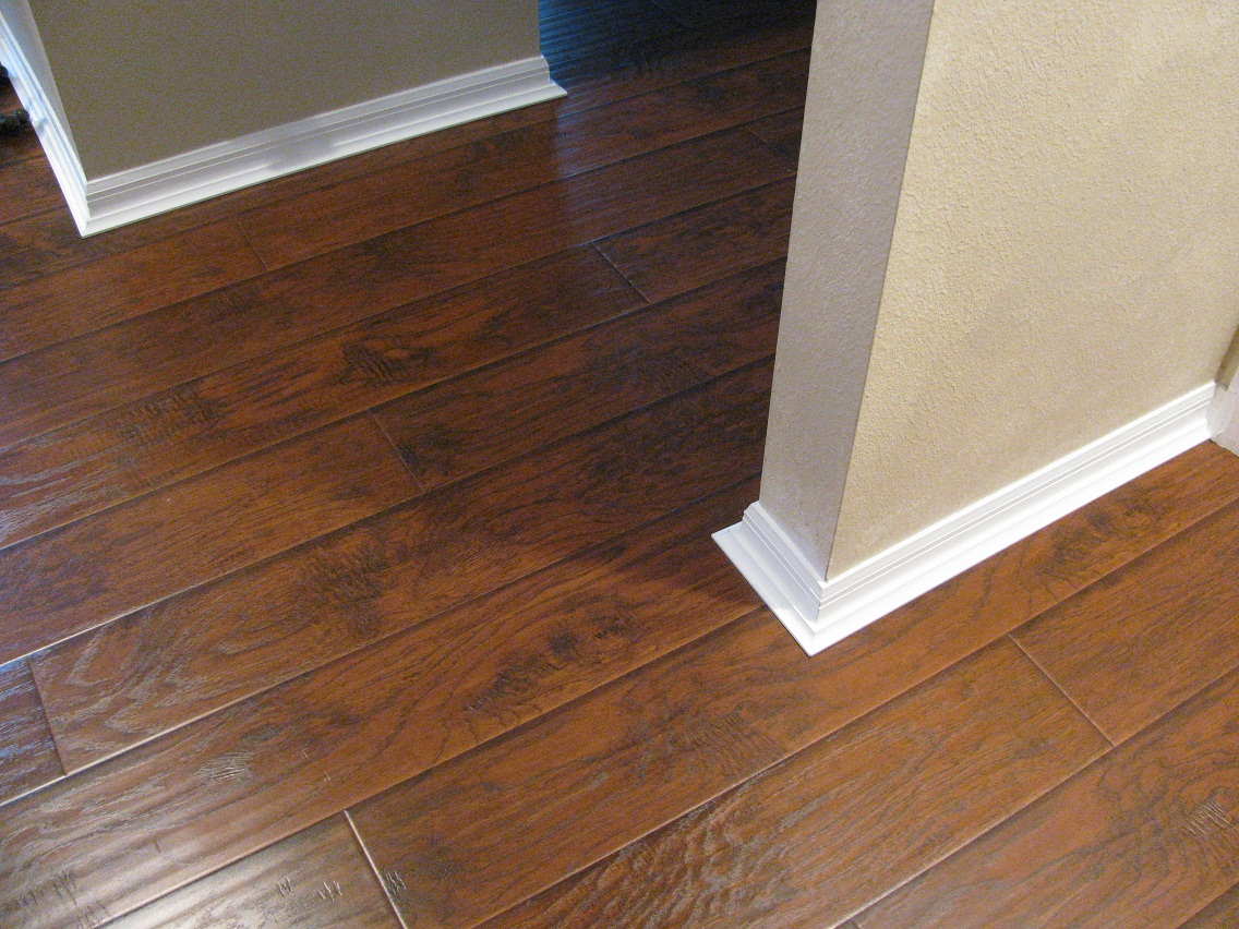 baseboard molding with Razor Clean Laminate Flooring