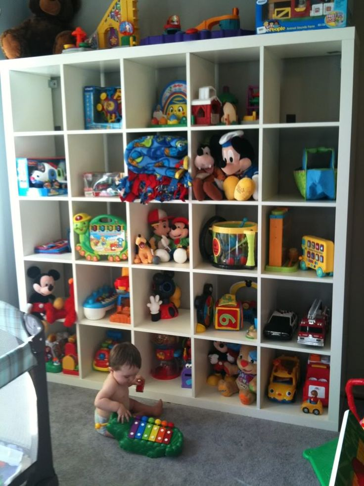 big ikea toy storage filled with dolls and toys with ceramic walls for lovely kids room ideas