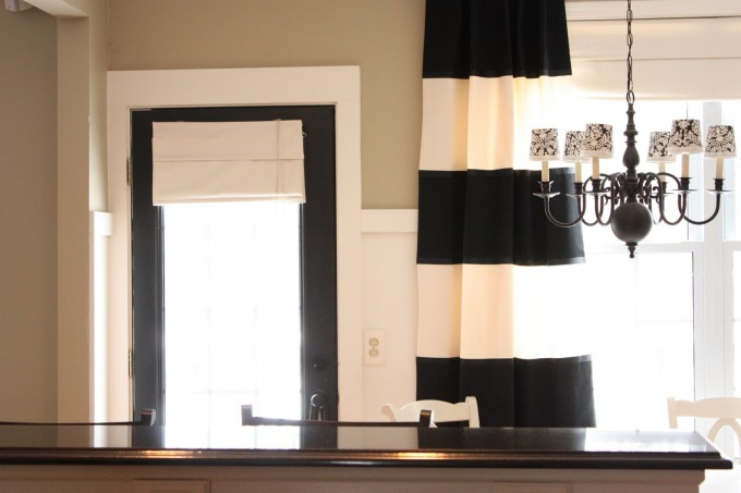 Black And Broken White Horizontal Curtains With Chandelier And Glass Door