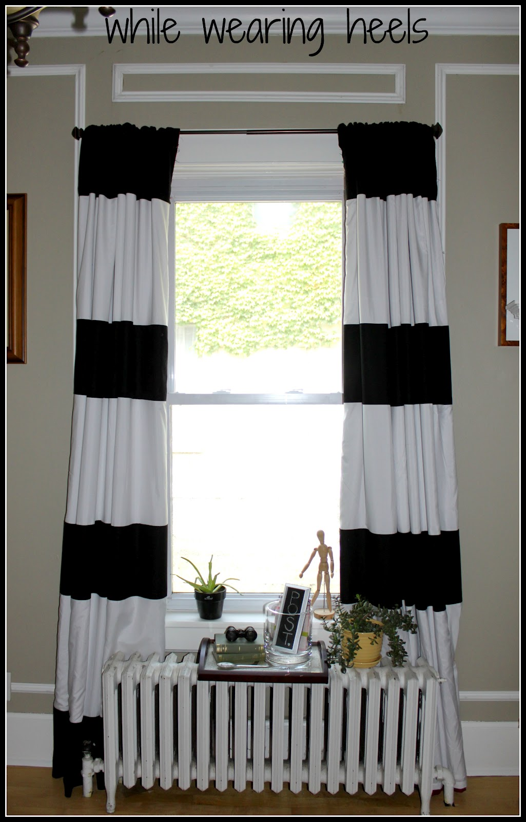 Black And White Horizontal Striped curtains with white table before single hung window