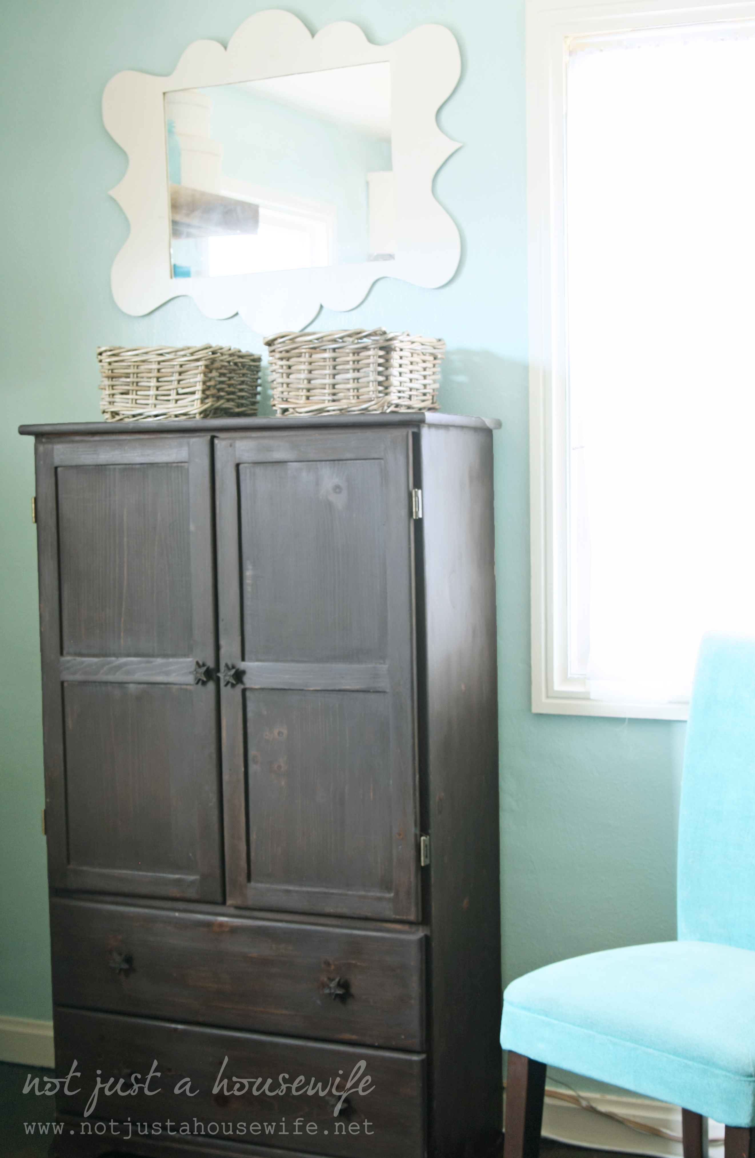 black computer armoire near window with cyan wall and mirror above for your home office decor ideas