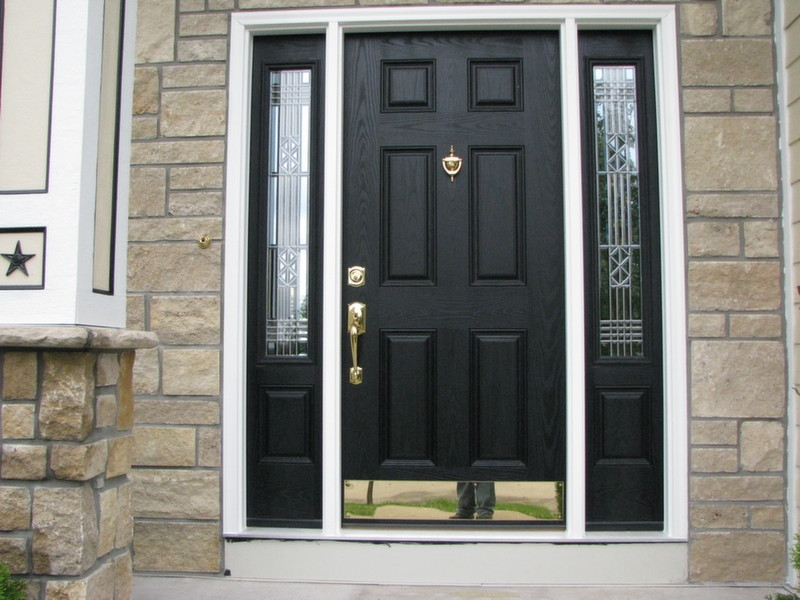 black entry door with sidelights with golden handle and murble wall
