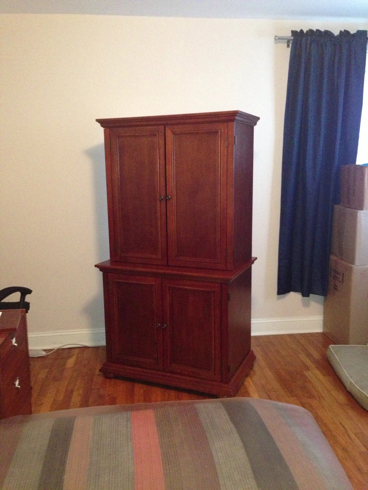 brown computer armoire with wooden floor and white wall plus blue curtain for your room interior decor ideas