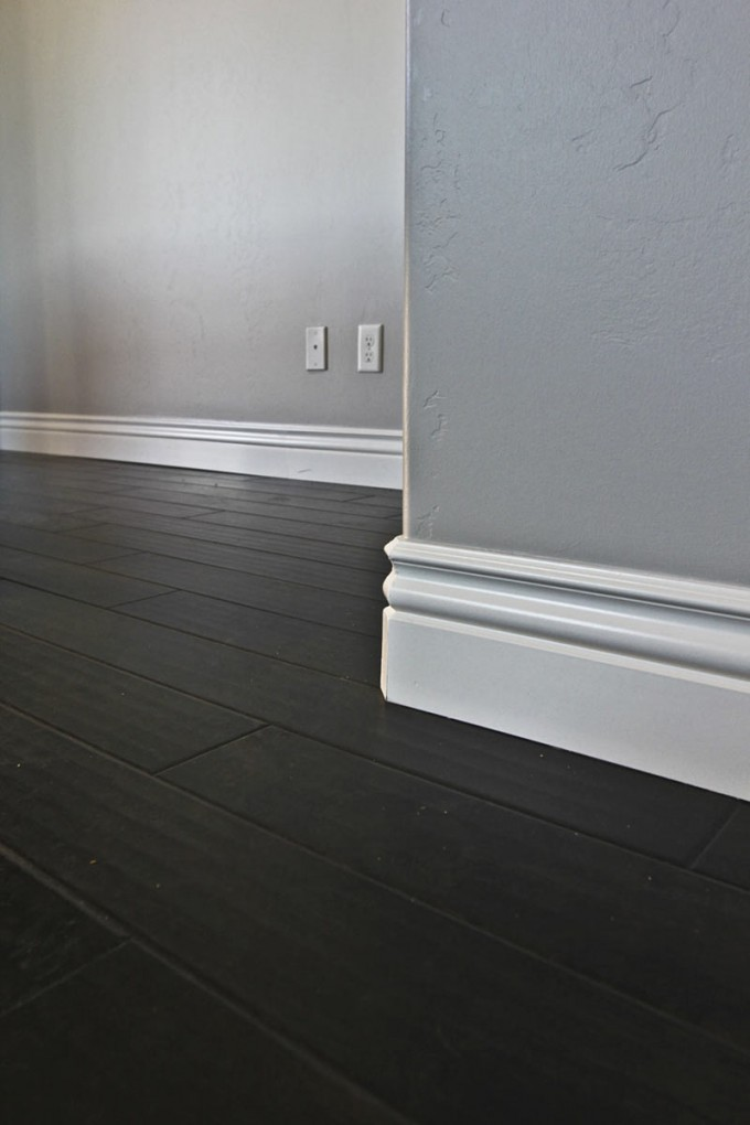 Charming Baseboard Molding With Grey Wall And Dark Floor