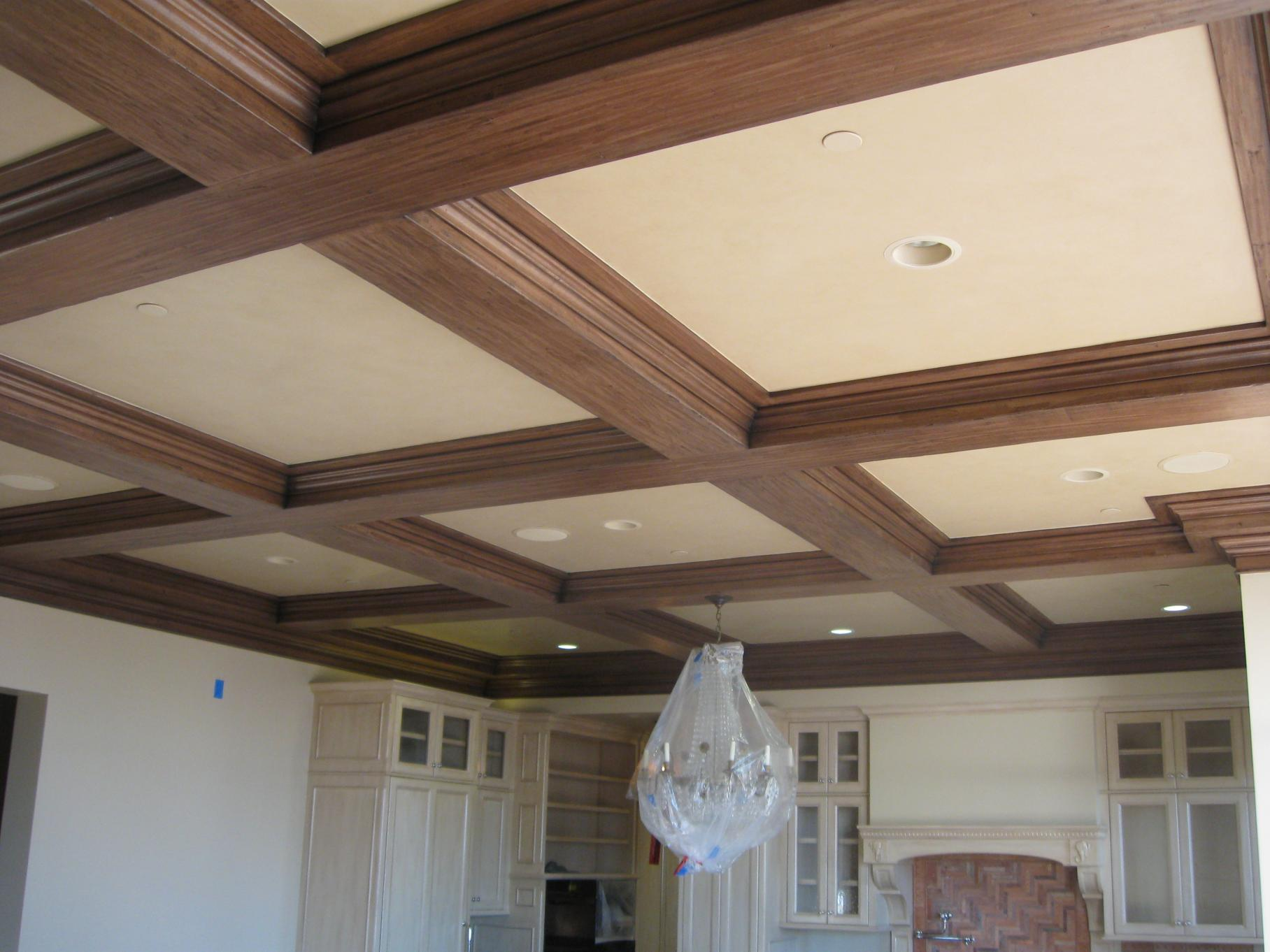 charming wood Coffered Ceiling with chandelier matched with white wall plus white cupboard