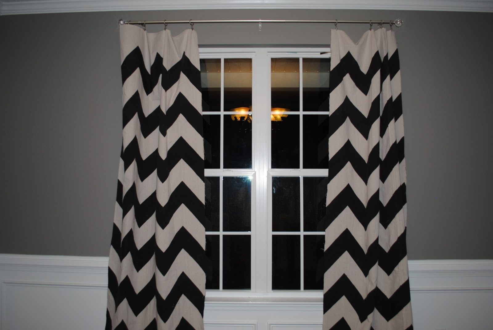 chevron curtains in black and white with window and grey wall