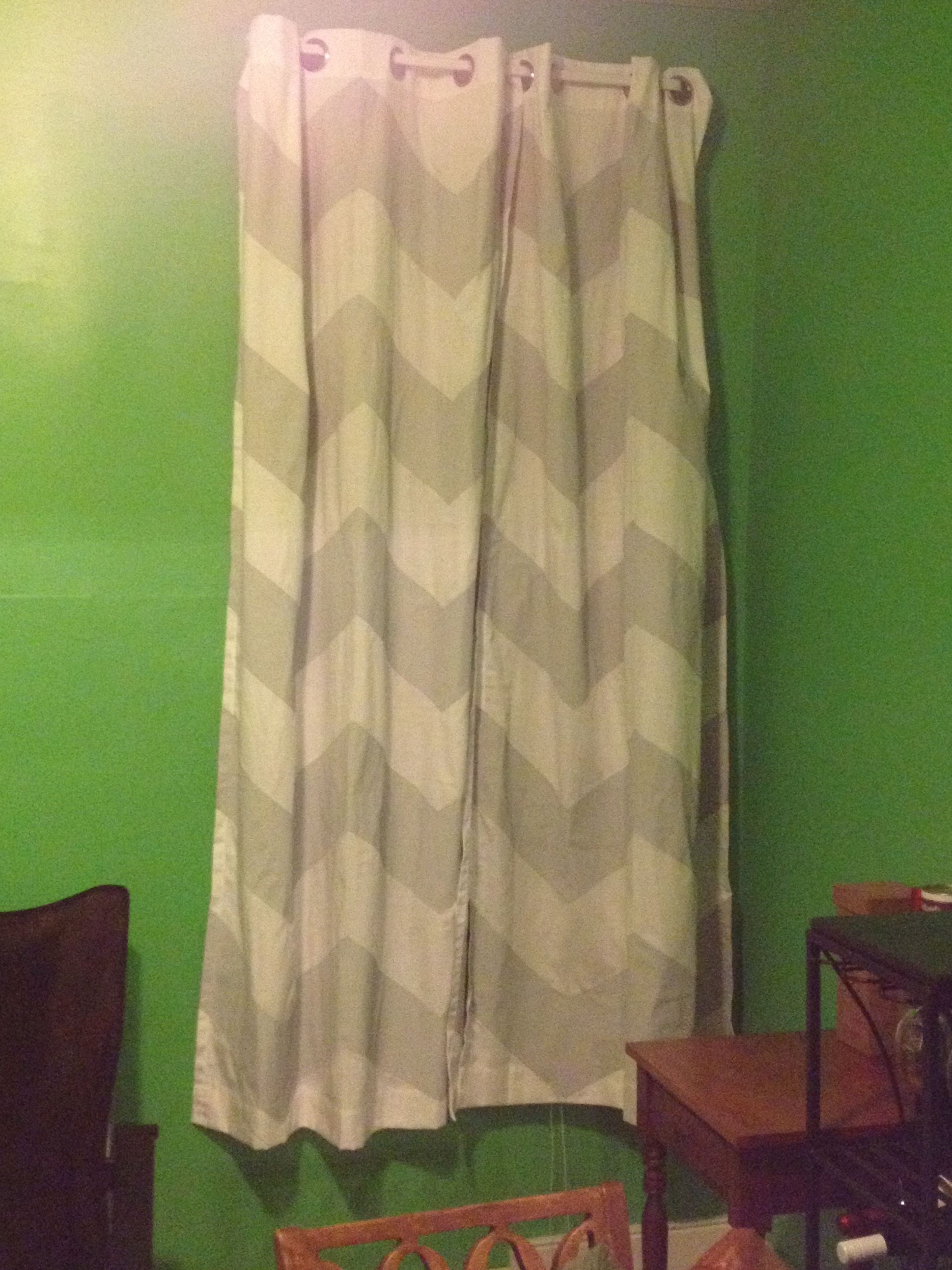 chevron curtains in green with green wall and wooden chair