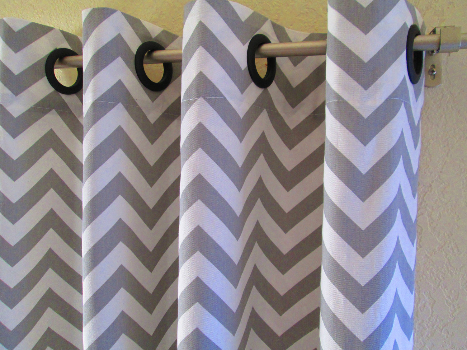 chevron curtains in grey and white with black rings