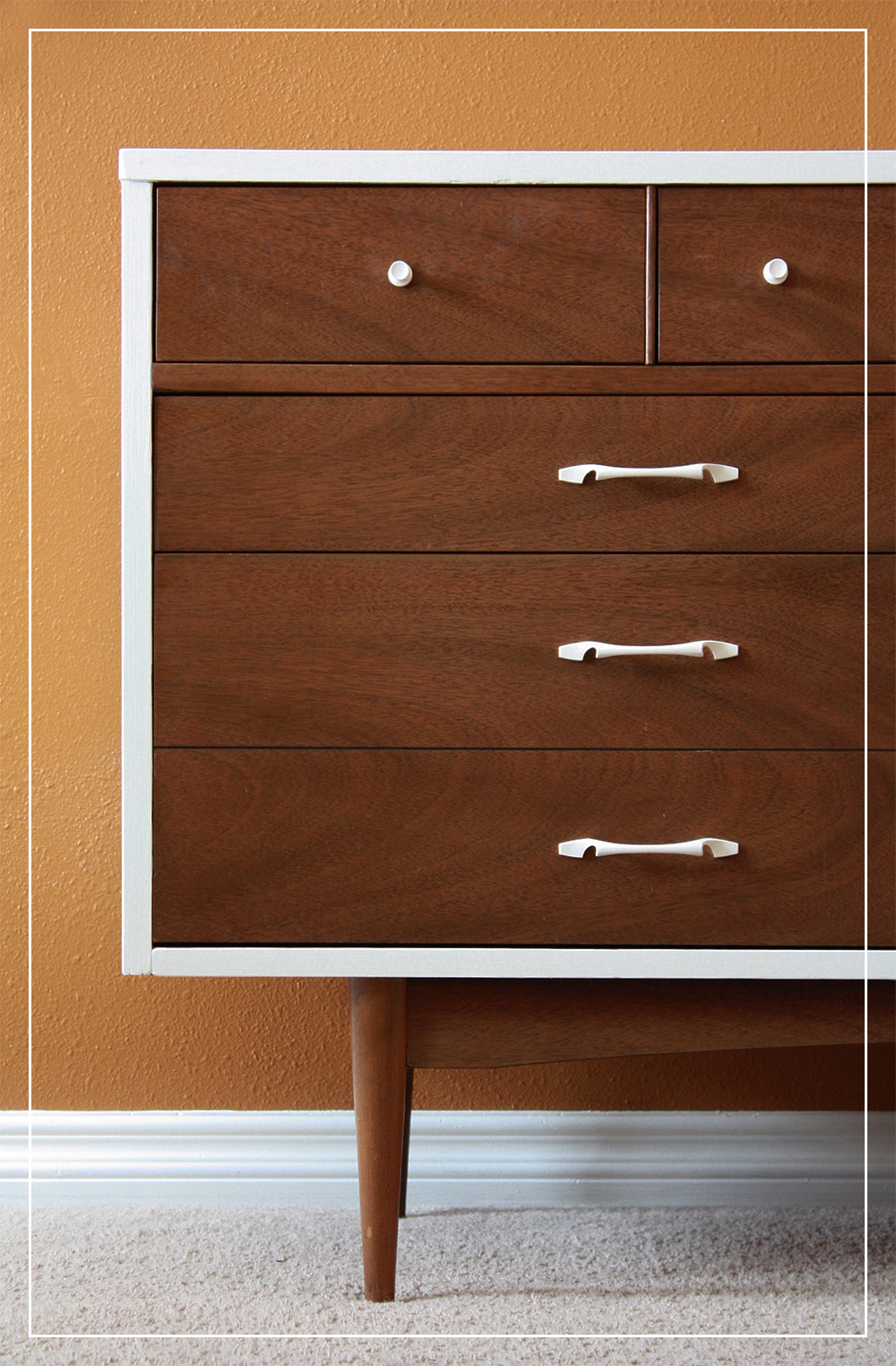 chocolate mid century dresser with white handle and white list