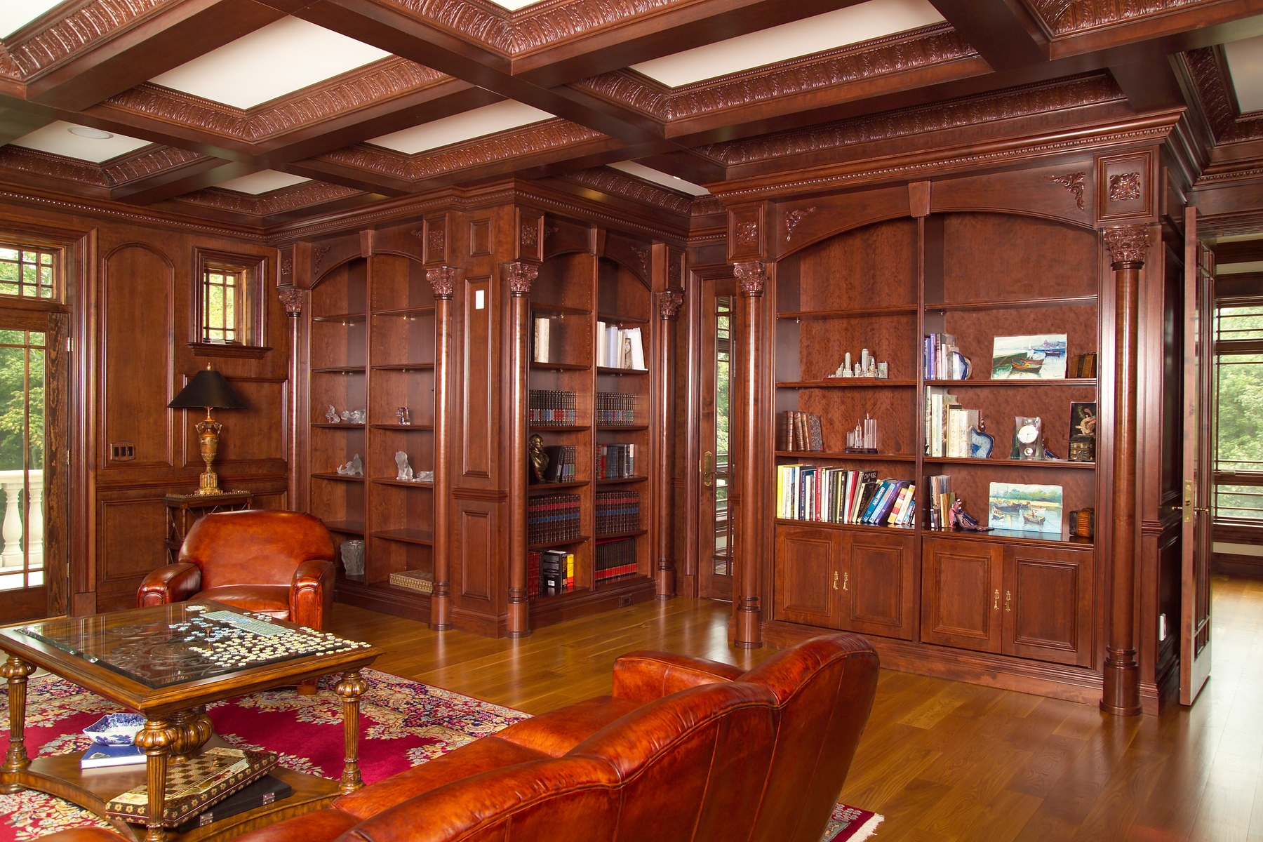 Classic Library Design With stunning wooden coffered ceiling and natural brown wood of book shelves plus wooden floor