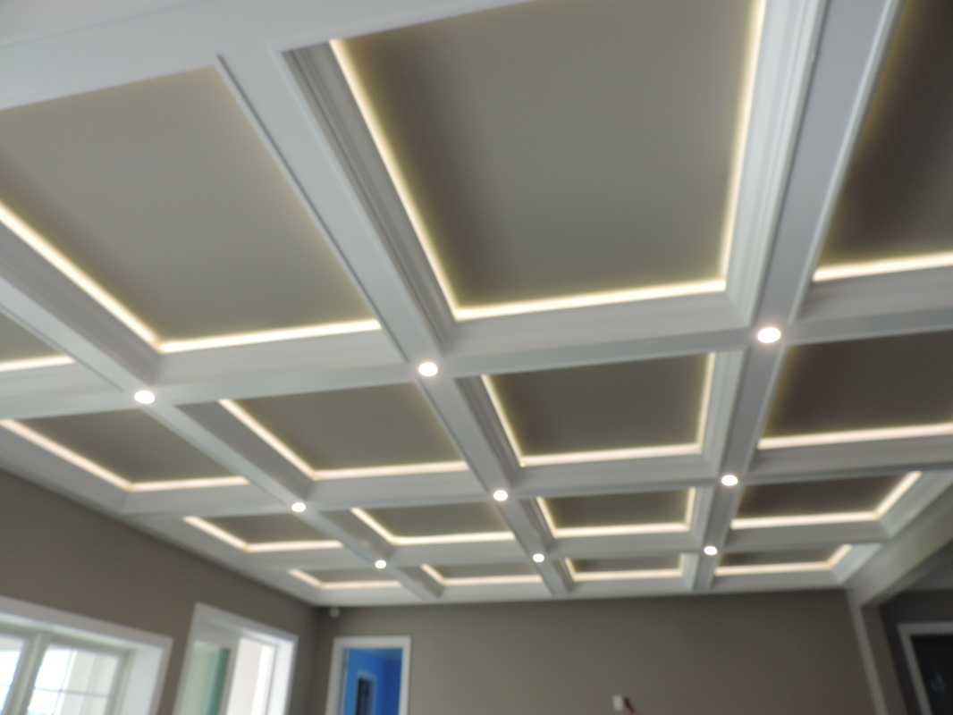 coffered ceiling with lights matched with grey wall and white window