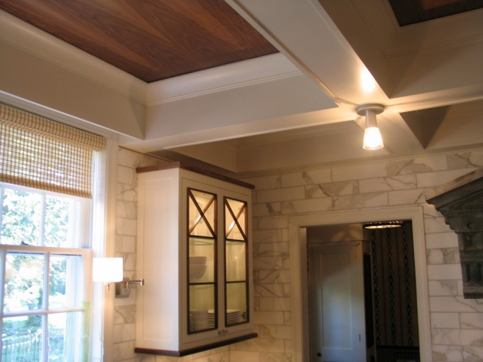 Coffered Ceilings In Wood With Lamp Matched With Stone Veneer Wall Plus Window