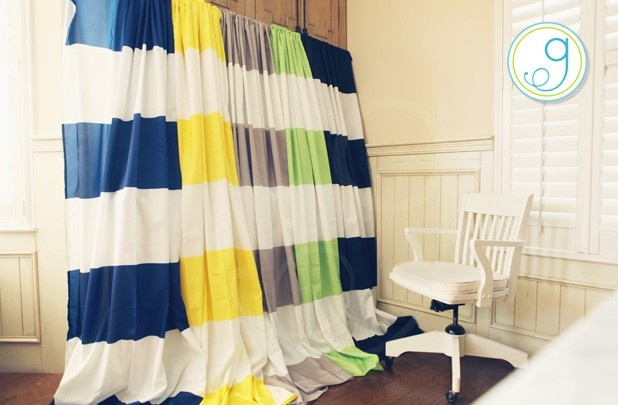 colorful horizontal striped curtains with white wall and wooden floor