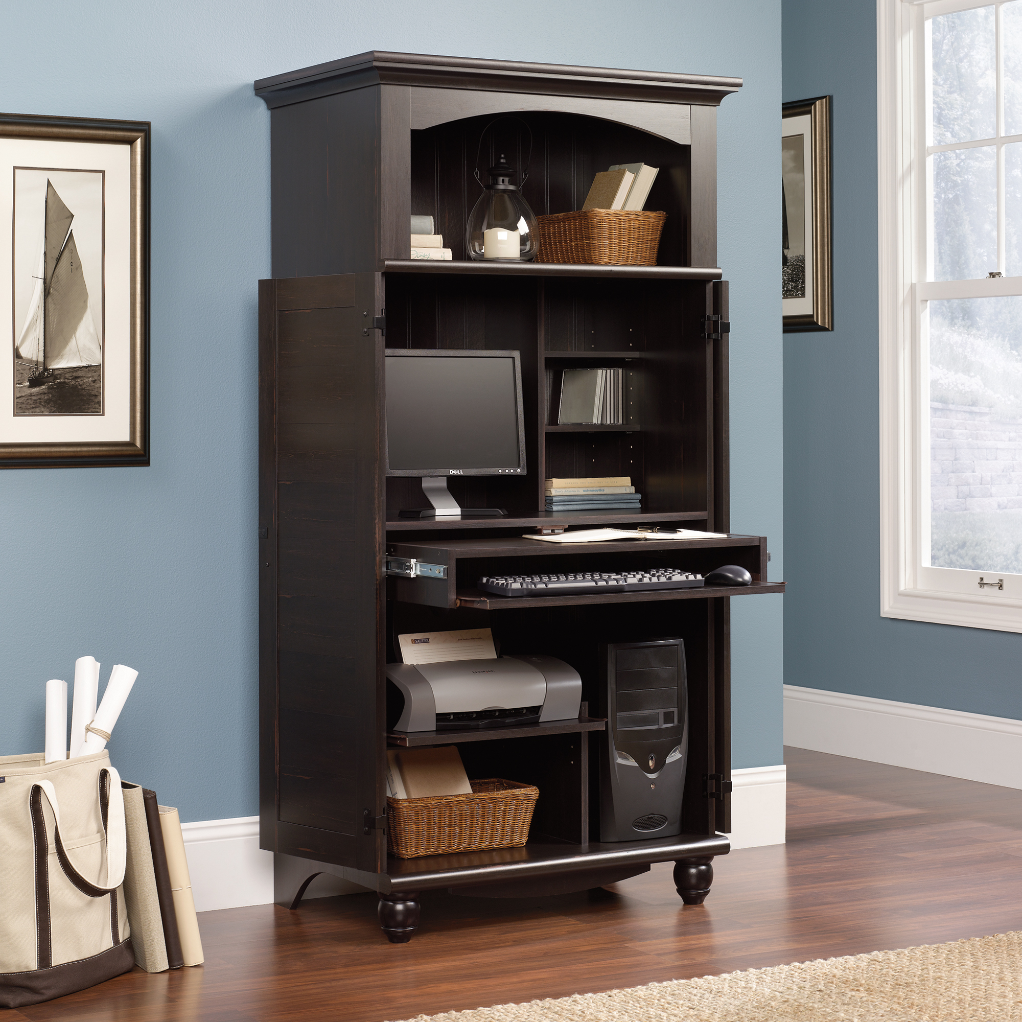 Computer Armoire in black with blue wall and picture
