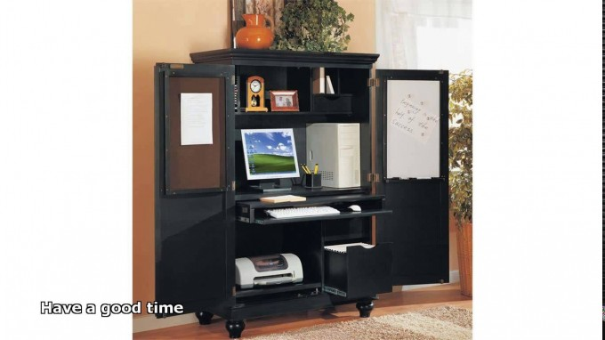 Computer Armoire In Black With Legs And Orange Wall