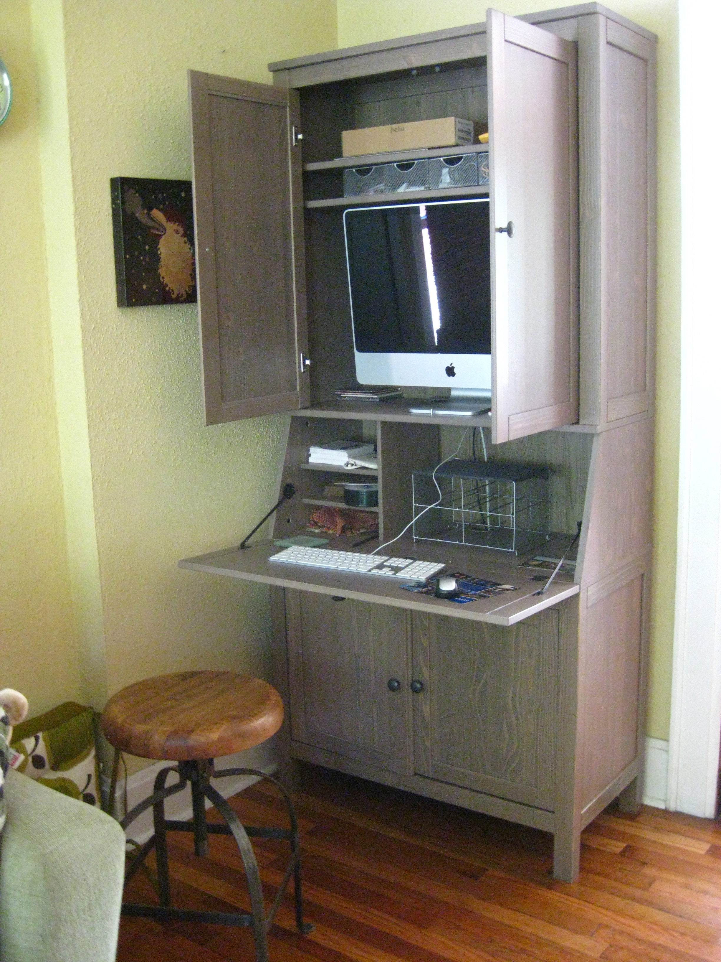 computer armoire with casement and hopper style with big sized computer monitor