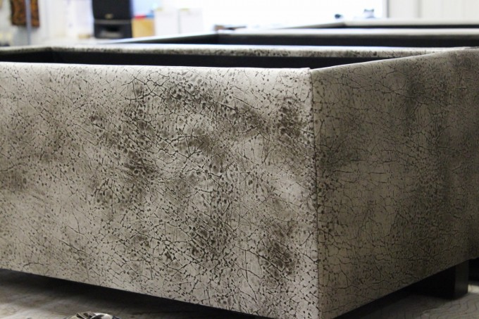 Corked Cowhide Ottoman With Small Legs
