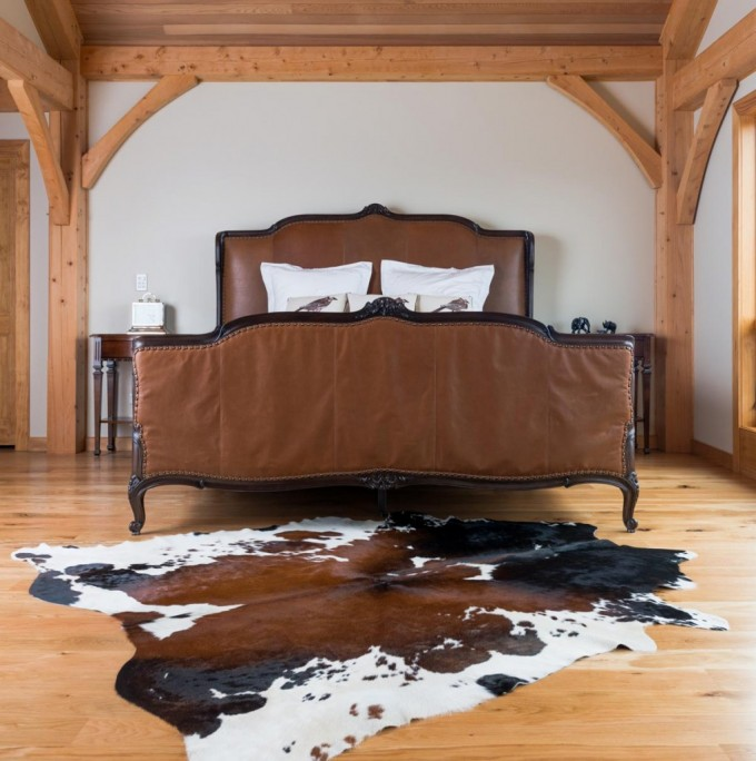 Cowhide Ottoman With Brown Color On Wooden Floor