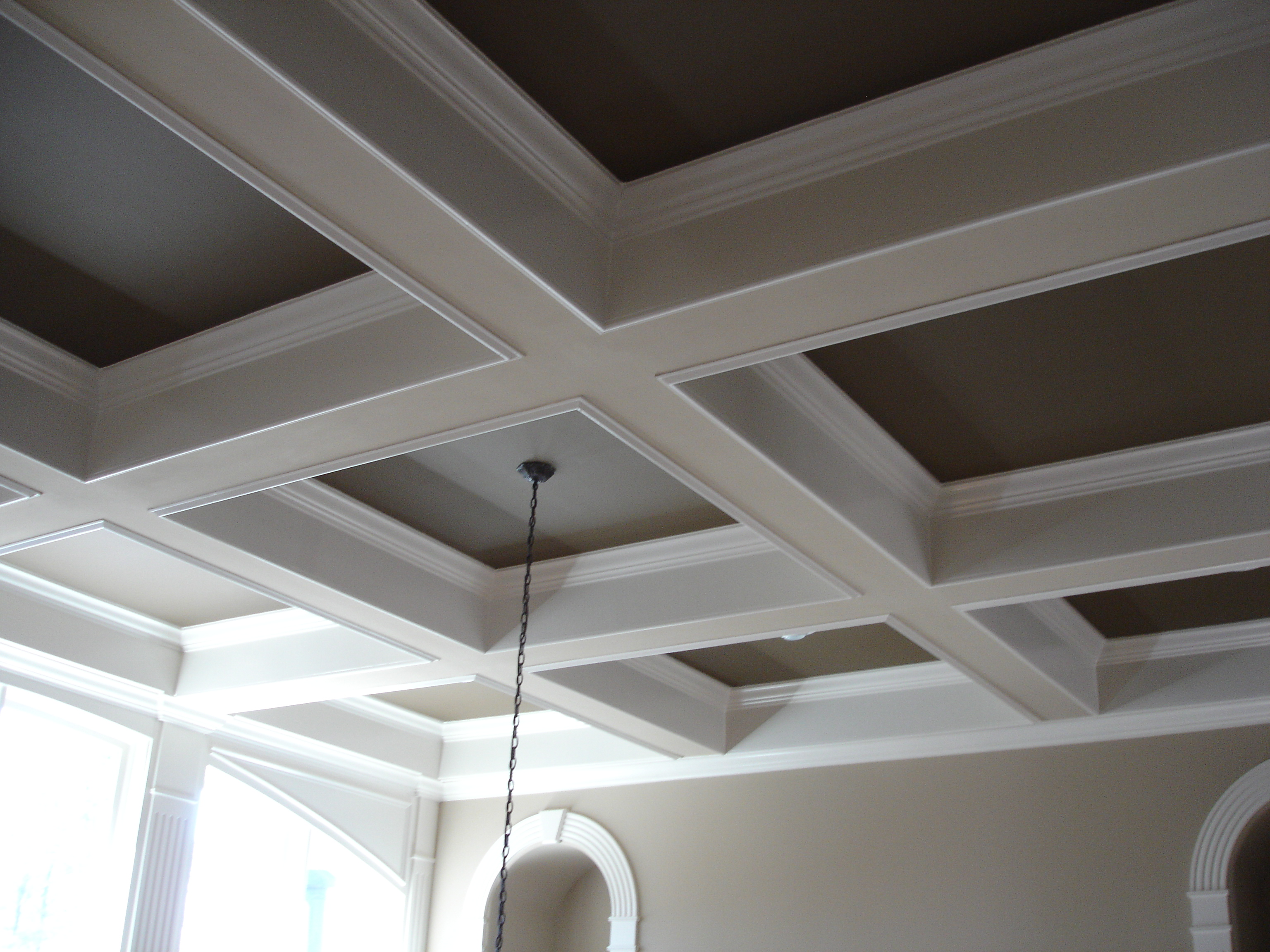 Custom Coffered Ceiling in whte and grey matched with grey wall plus chandelier