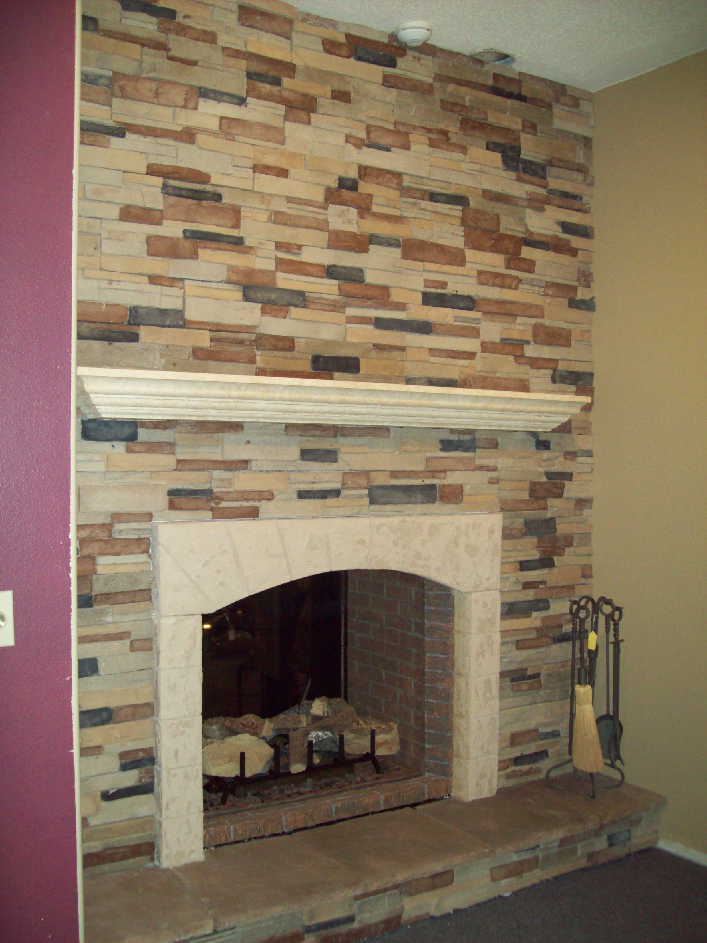decoration of fireplace with stone veneer panels plus purple wall ideas