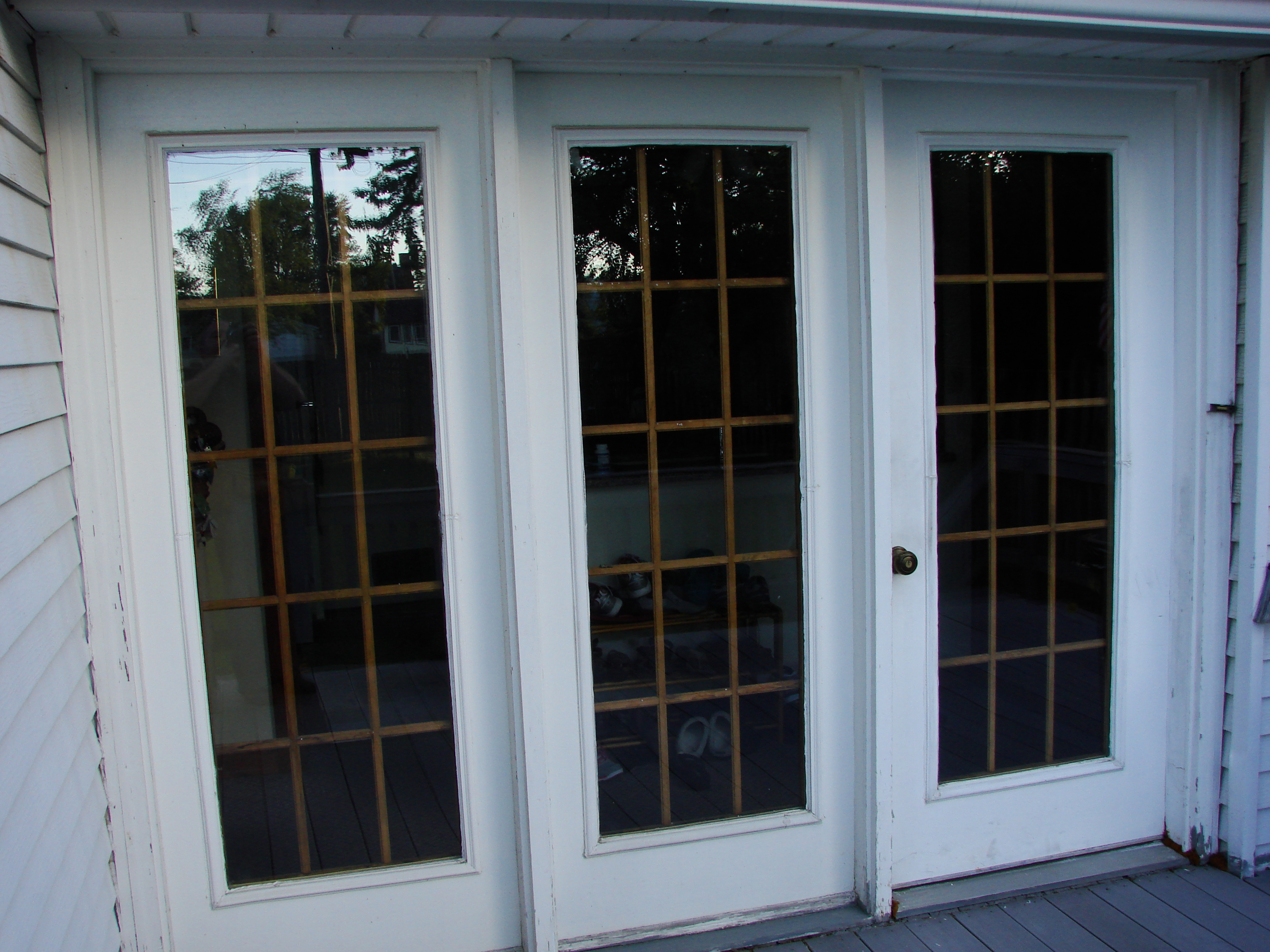 double entry door with sidelights with wood floor and white ceiling