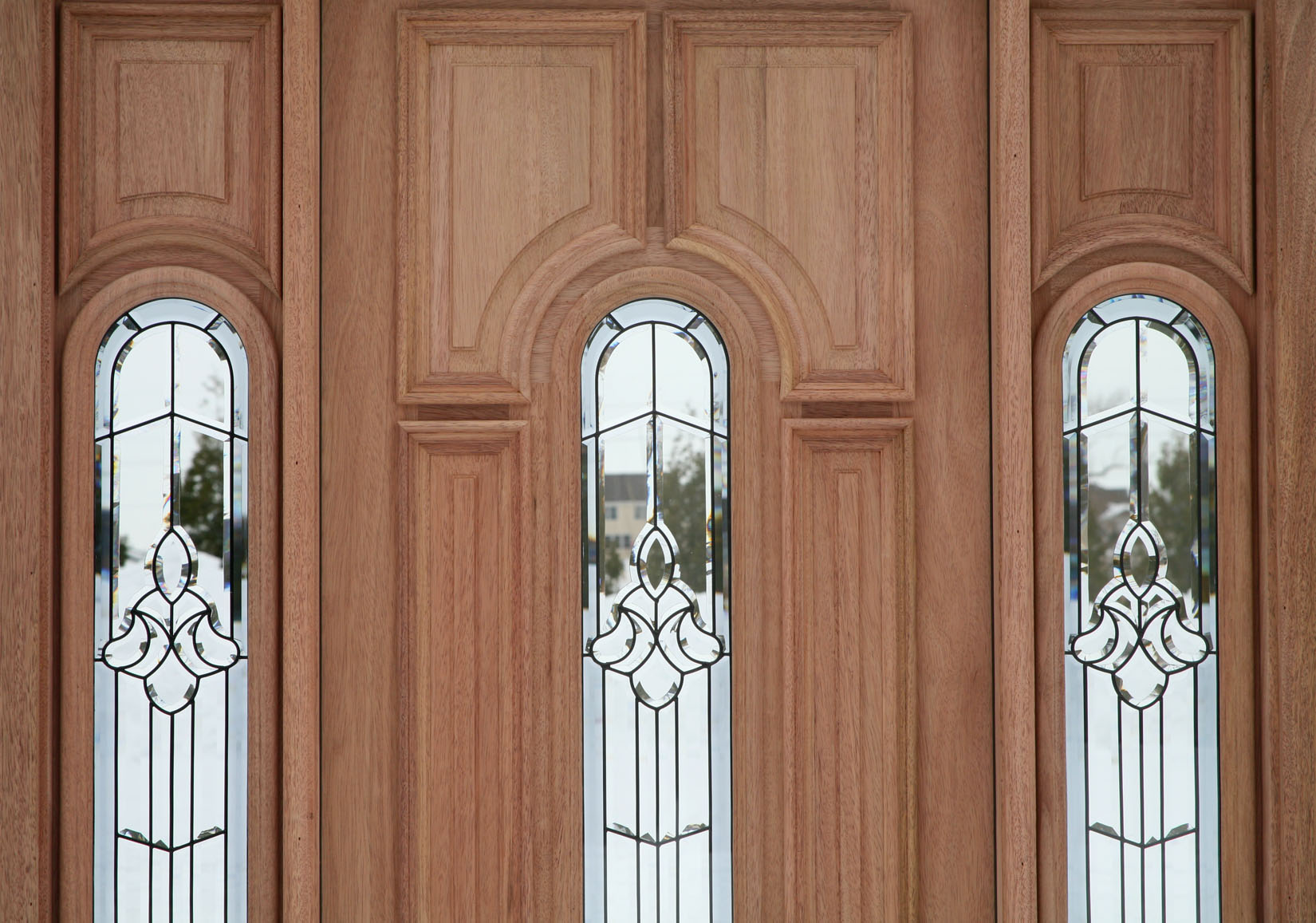 entry door with sidelights in cream with glass touching