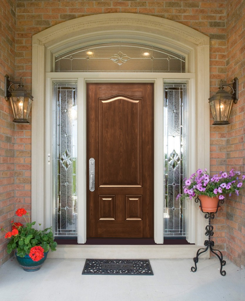 Entry Door With Sidelights with arc and double lamps on wall plus flowers