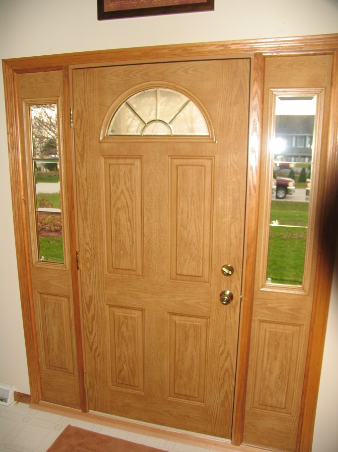 Entry Door With Sidelights With Arch And Golden Handle Matched With White Wall