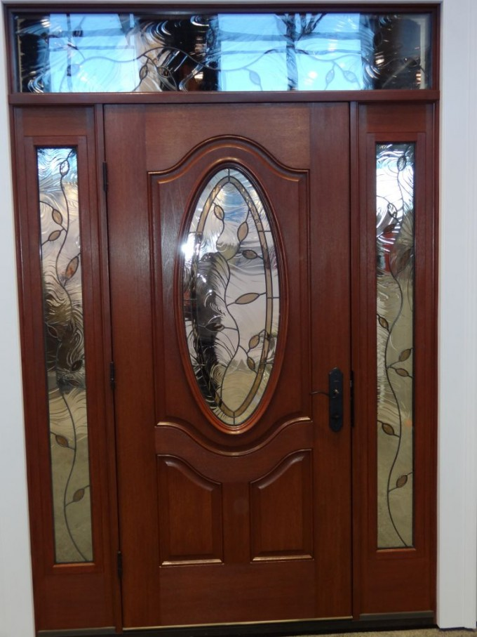 Entry Door With Sidelights With Black Lever Handle Plus Leaf Ornament And Arch