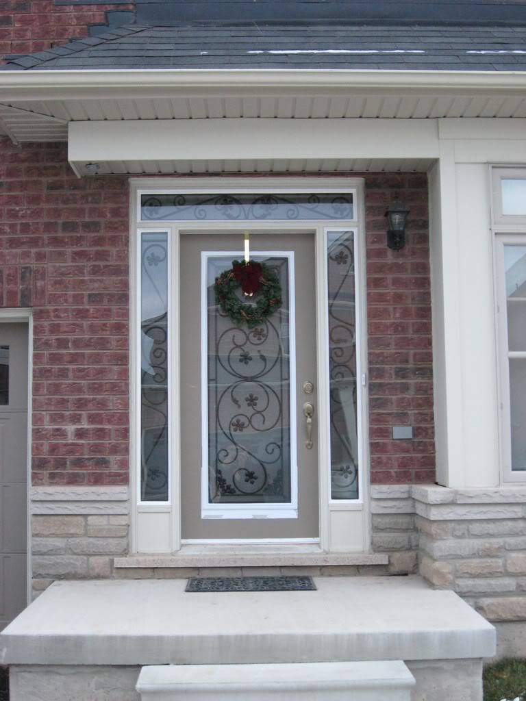 Entry Door With Sidelights with christmast ornament matchet with brick wall