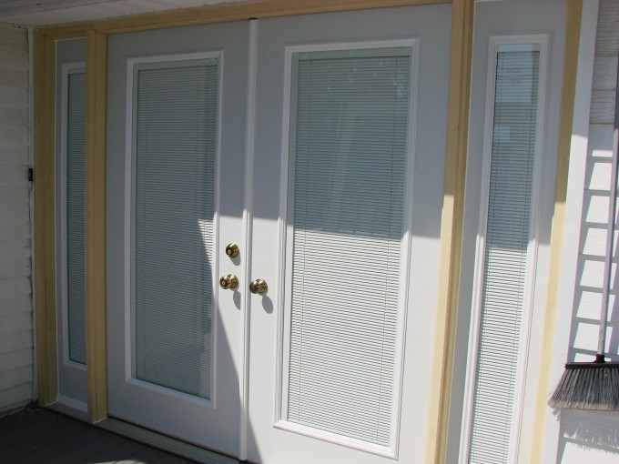 Entry Door With Sidelights With Doorknob Handle And Yellow List Surround