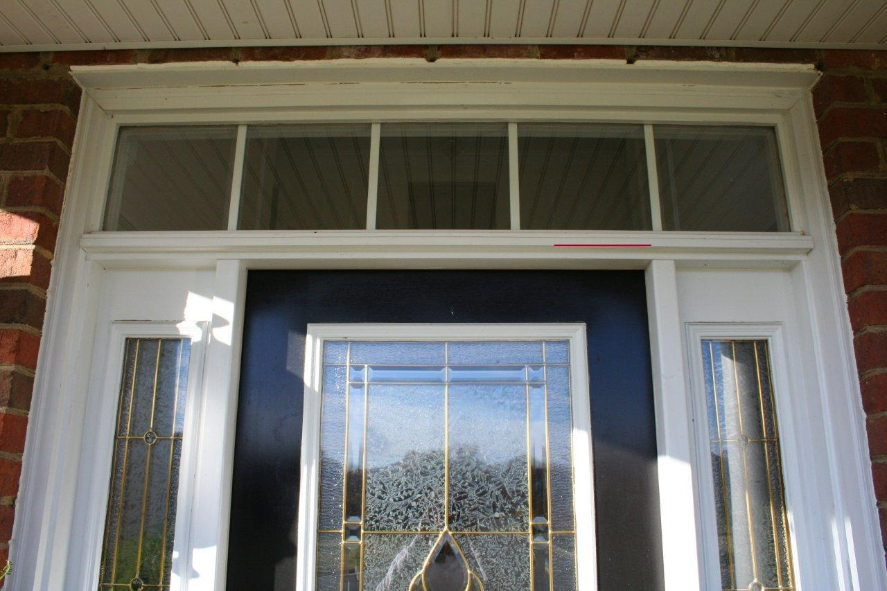 entry door with sidelights with double glass window and wood ceiling