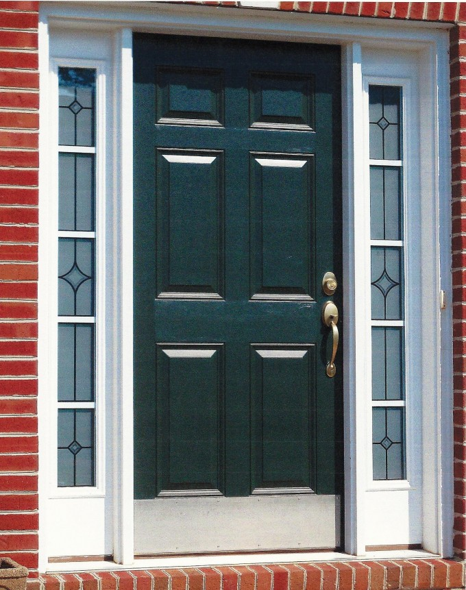 Entry Door With Sidelights With Golden Handle And Brick Touching On Wall