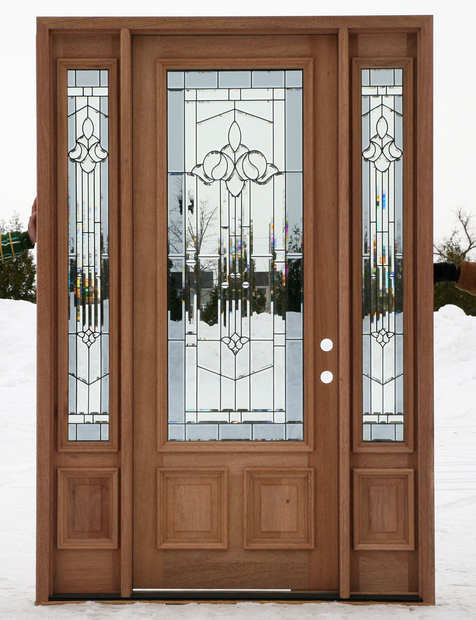 Entry Door with Sidelights with white handle on snow