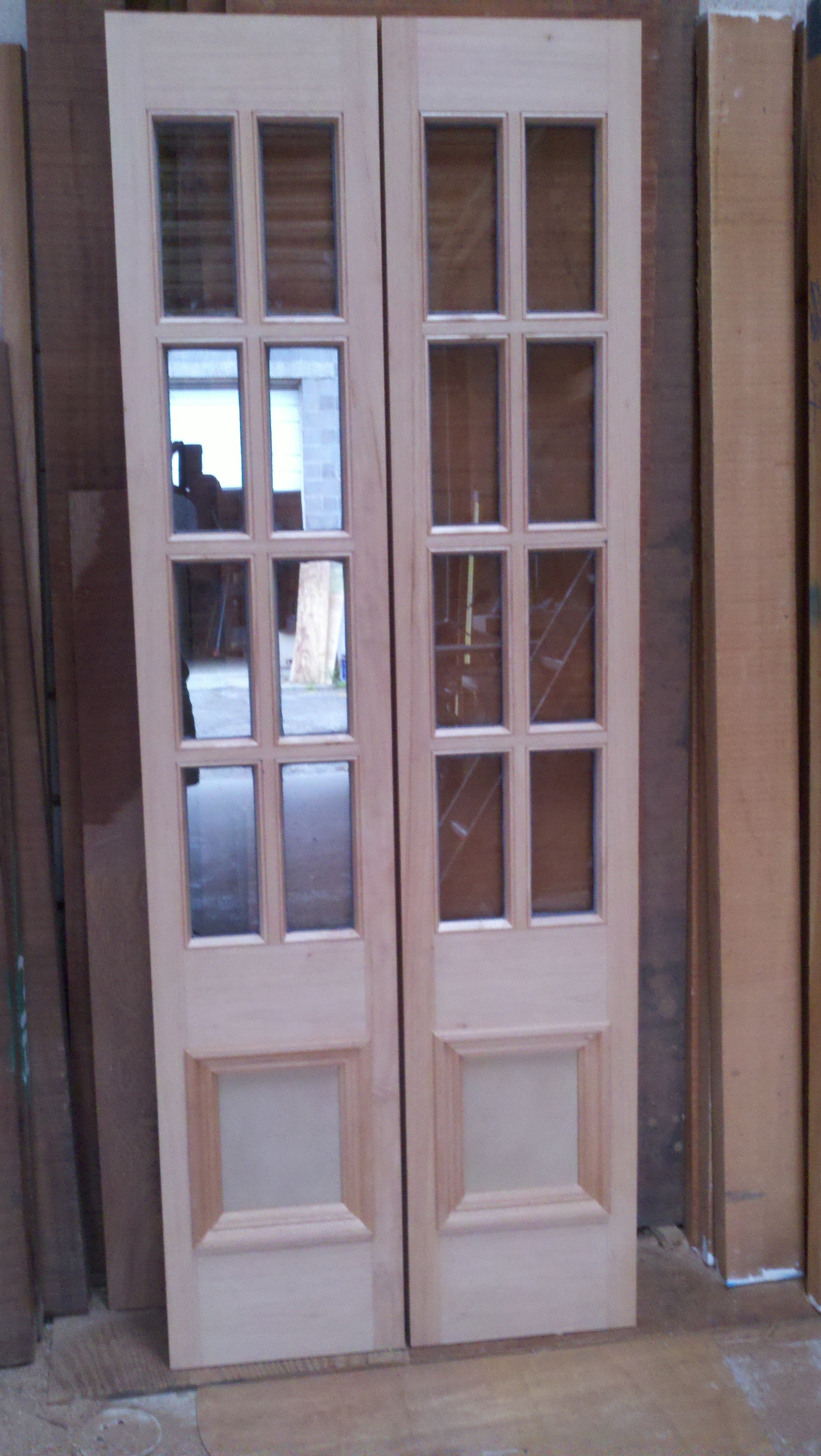 entry door with sidelights without handle in cream with ceramic floor and tan wall