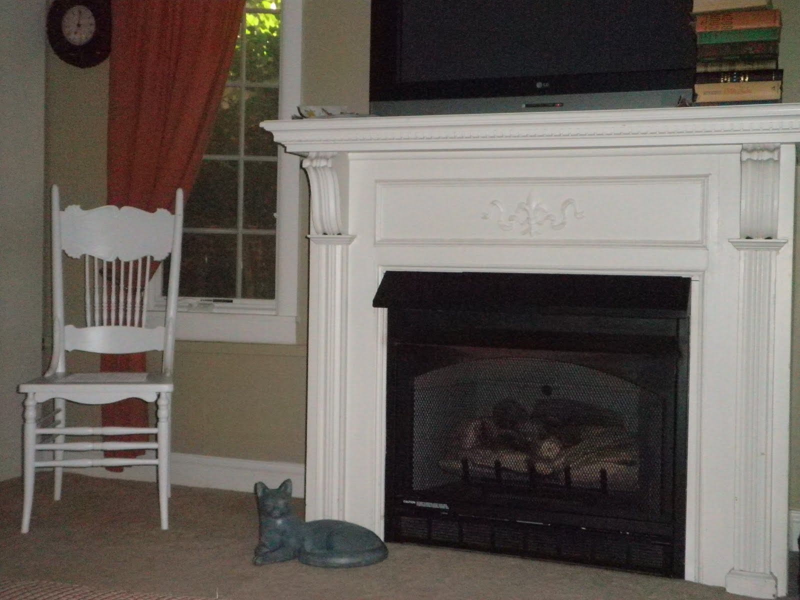 fireplace mantel kits under tv and near window with chair and ceramic floor