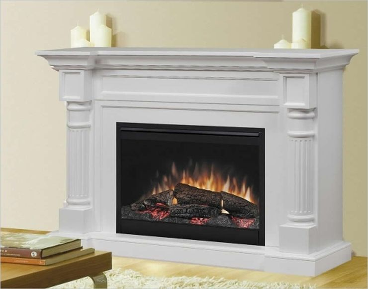 Fireplace Mantel Kits with chandels above and books on wooden table
