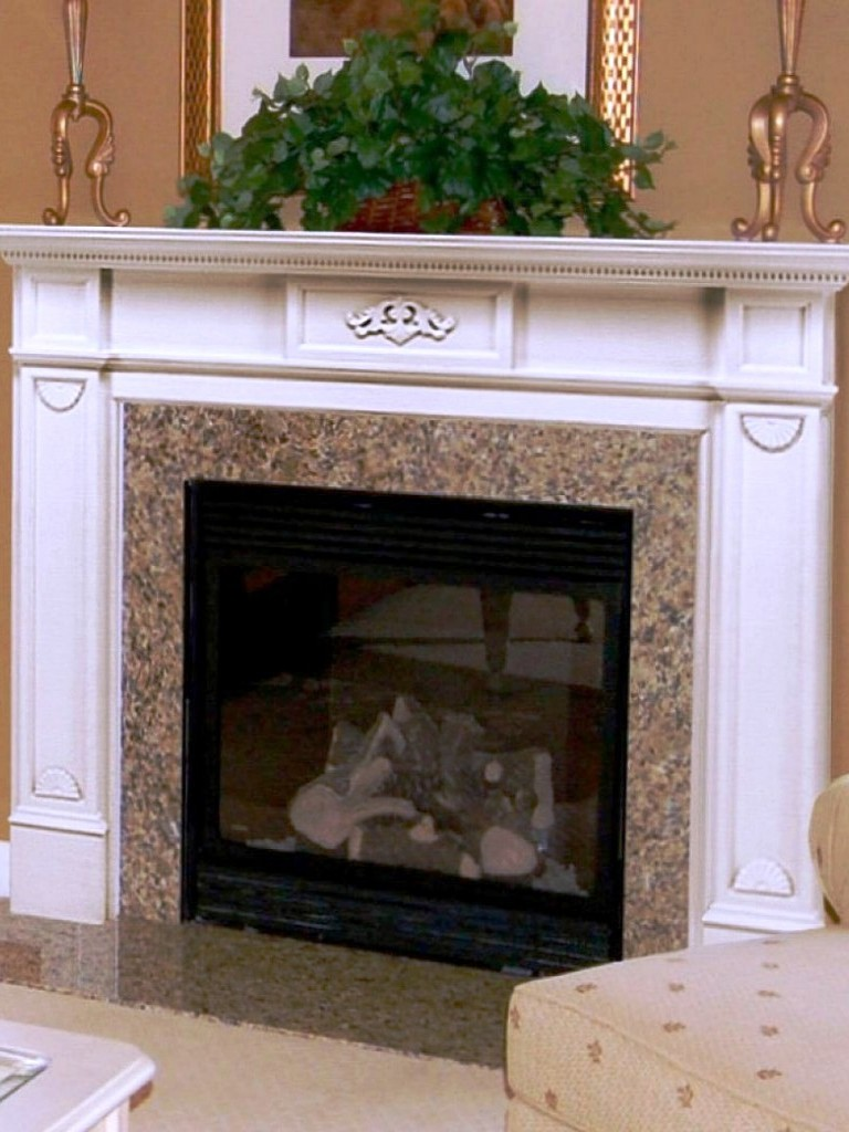 Fireplace Mantel kits with flower vase and doulbe chandel holders above