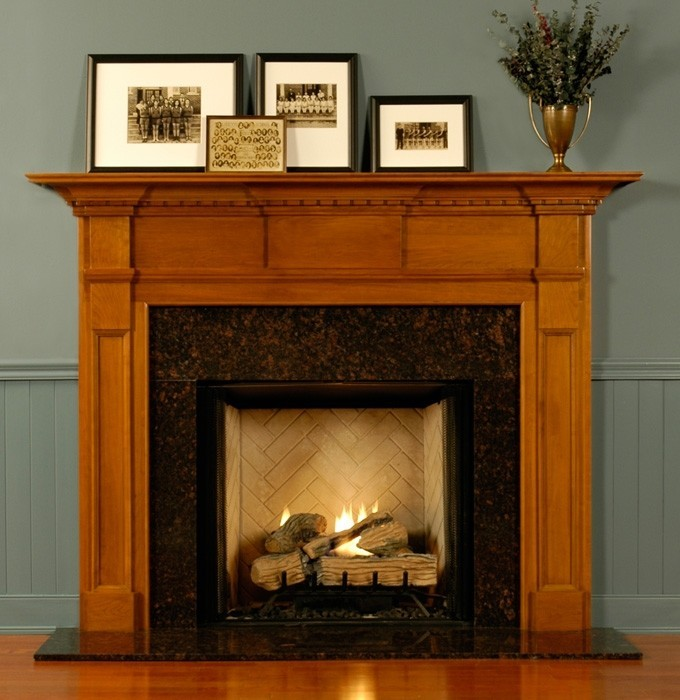 Fireplace Mantel Kits With Four Frames Above And Grey Wall Plus Wooden Floor For Home Decor Ideas
