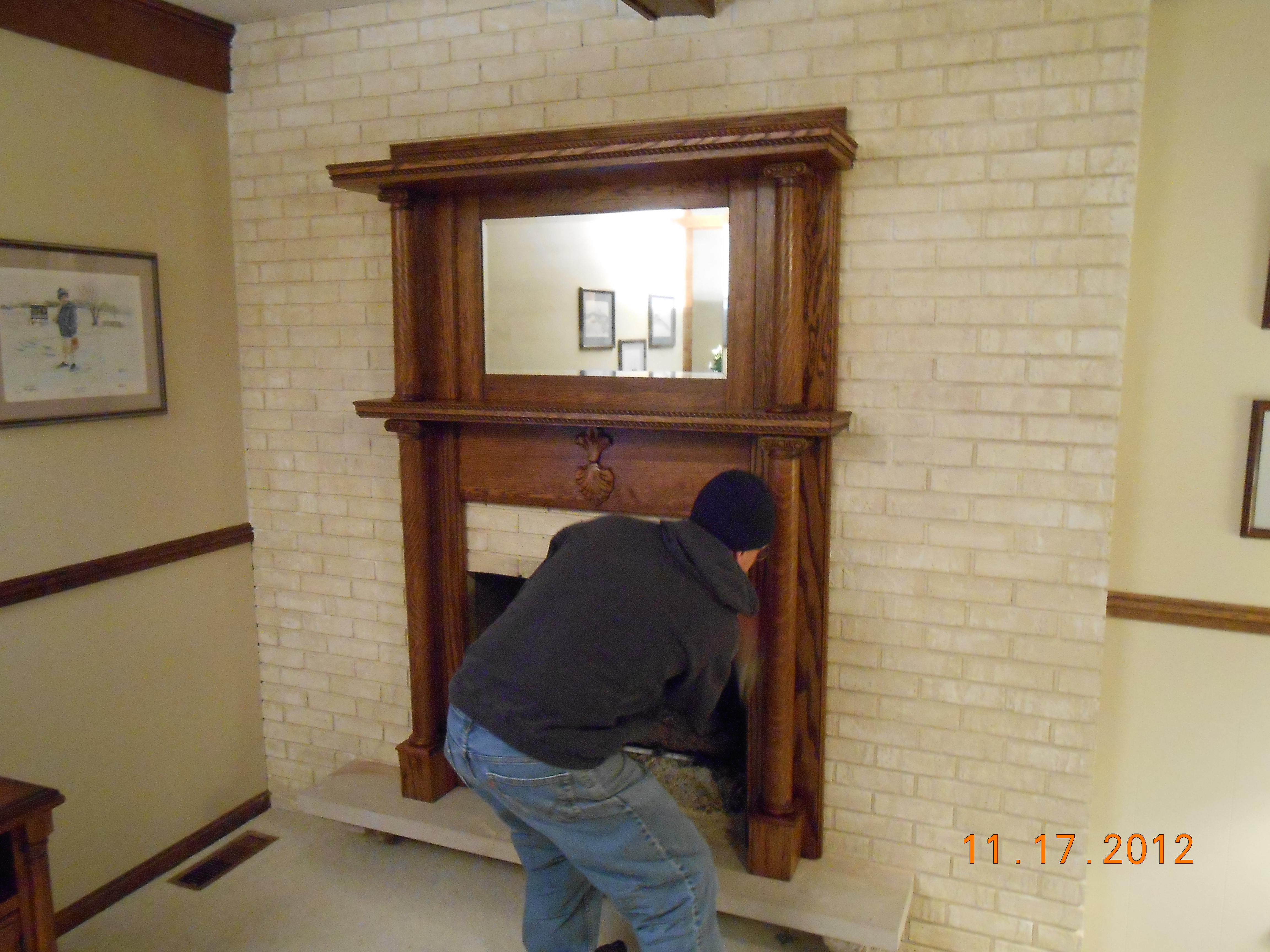 fireplace mantel kits with mirror above and brick touching wall
